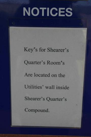 "Wall notice reading ""Key's for Shearer's Quarter's Room's Are located on the Utilities' wall inside Shearer's Quarter's Compound."""