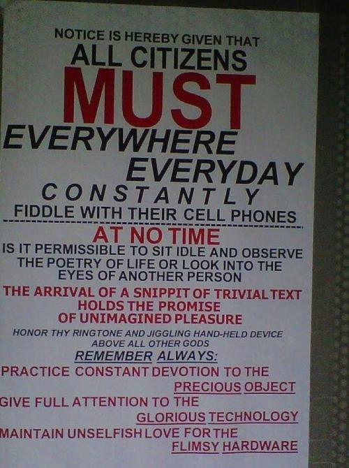 """official"" notice requiring all citizens to ""constantly fiddle with their cell phones"", ""give full attention to the glorious technology"" and ""maintain unselfish love for the flimsy hardware"""