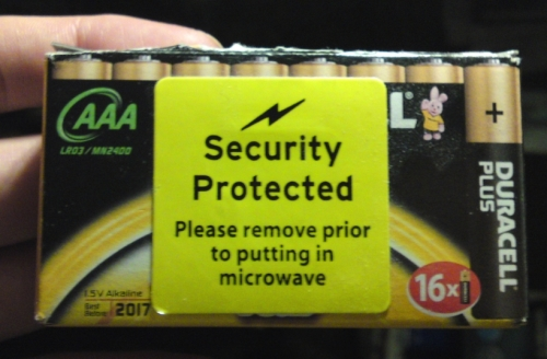 "Box with sticker: ""Please remove prior to putting in microwave"""
